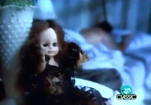 The video begins with a doll with brown hair reminiscent of Laura.