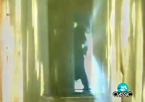 When Laura finally reaches the end of the hallway, we briefly see the masked man who was waiting for her the entire time.