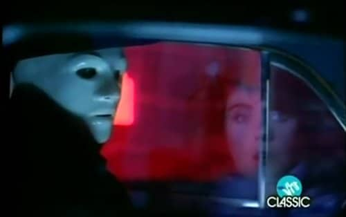 The masked man appears to entrance Laura as he tells her to follow him.