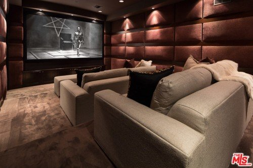 "John Legend and Chrissy Teigen put up their Beverly Hills Estate for sale and this is the image of their home theatre. It features Maria from the movie Metropolis standing in front of an inverted pentagram. As stated in previous articles, this specific scene is constantly rehashed by the occult elite to reprent the control of ""android"" stars to push the agenda of the occult elite."