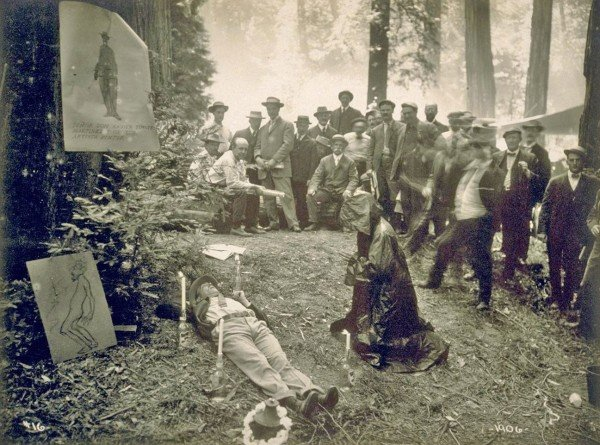 To purge himself of worldly concerns, a member of the elite Bohemian Club participated in a 1915 Cremation of Care ceremony - complete with candles and a robed and hooded comrade to guide him.