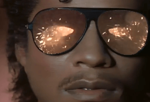 In the first shot of the video, we see explosions behind the shades, implying the the impending blowing of his mind.