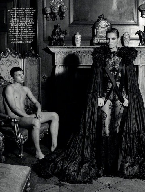 "The caped Kate Moss, representing the ""Mother of Darkness"" in Monarch programming, casts a dark shadow next to a helpless, naked slave."