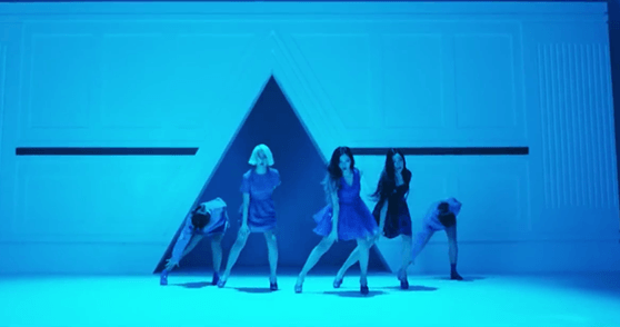 "In this choreography scene, on the three group members stand up while two of them remain bowed down. Is this a veiled reference to the two ""fallen members""?"
