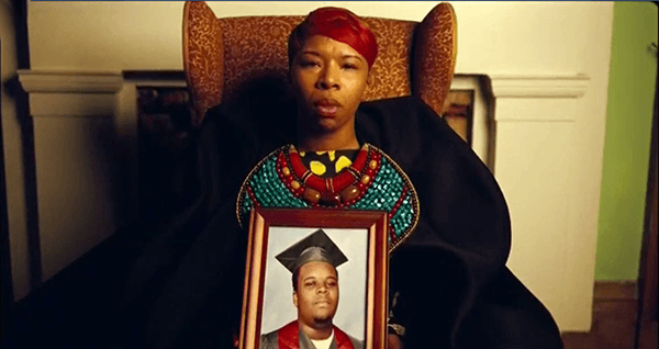 During the song Forwards, pictures of Black men deceased at the hands of police are held by their mothers.