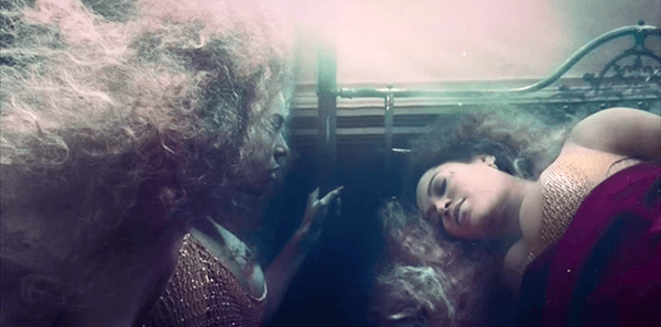 Beyoncé ends up in a room underwater - symbolic of the womb and impending rebirth. There, her old self sees her new self.
