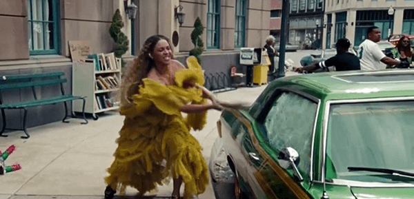 Beyoncé walks in the streets of New Orleans and starts breaking cars with a baseball bat. She's not only breaking the car of her cheating husband - she's breaking random cars.
