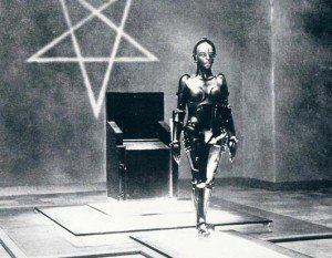 In Metropolis, Maria is a leader trusted by her people. The occult elite uses android to take on her likeness to mislead the people into following the elite's plans. Here, the android (before taking on Maria's likeness) stands before an inverted pentagram, hinting that the people that control her are all about occult and Black magic.