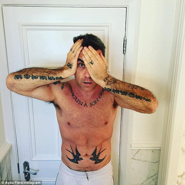 Industry veterans also must periodically tell the world that they are owned by the elite. Robbie Williams does just that on Instagram.