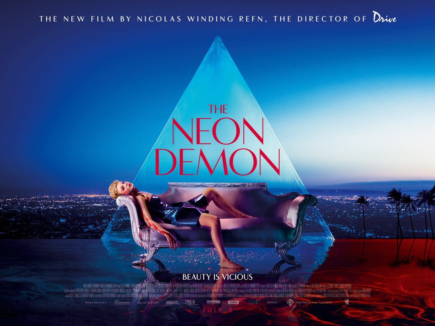 "The Neon Demon is a film about ""an aspiring model in Los Angeles whose beauty and youth place her in significant danger amongst the women she becomes associated with in the industry, who are murderous and dangerous"". In short, it is about the Satanic industry. In this poster, the model is laying bloody while the elite's pyramid is in the background."