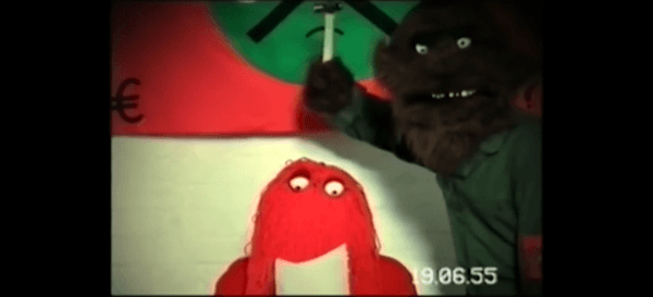 Red Guy forced to read a memo under threat of being hit on the head with a hammer by some monster. The date is still June 19th 1955.