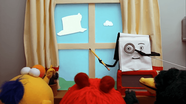 The notepad teaches the puppets how to watch clouds creatively.