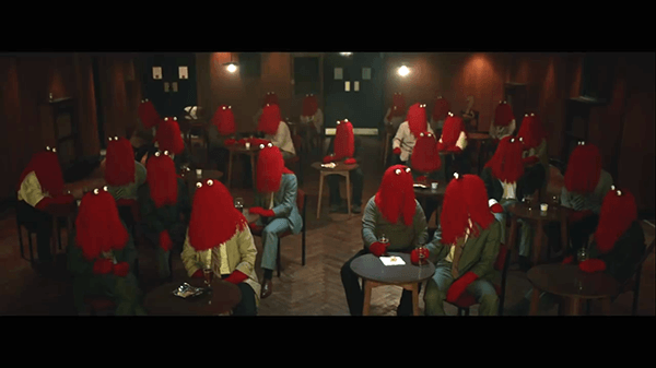 After work, Red Guy goes out. Everybody looks the same. This is the result of mass media programming which produces clones who basically think and act the same.