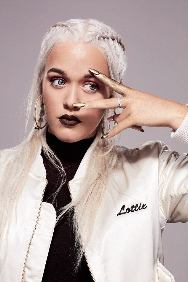 "According to crappy celeb sites, Lottie Tomlinson (the sister of One Direction's Louis) is the ""next big thing?"". Judging by this One-Eye sign, she is already owned by those who decide who is the ""next big thing""."