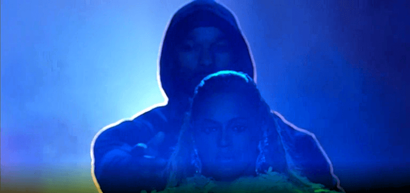 "The hooded man brings Beyoncé forward and lets her go, as if saying ""This is the path you must take""."