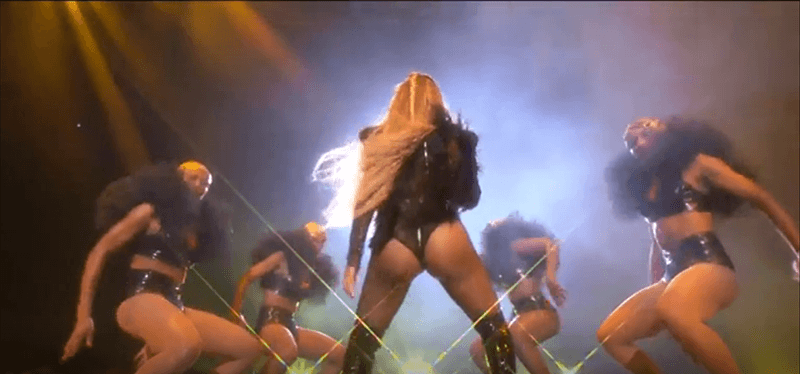After the stage of purity (white), ritual sacrifice (red) comes black - the color of completed occult transformation. Beyoncé is doing what the industry is expecting from her - shaking her booty.