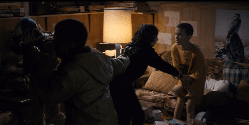 Eleven, who is all wet from the rain, is given a change of clothes. She immediately undresses in front of her friends, causing them to freak out. This scene portrays the lack of privacy and boundaries in the mind of MK slaves and implies sexual abuse in her past.