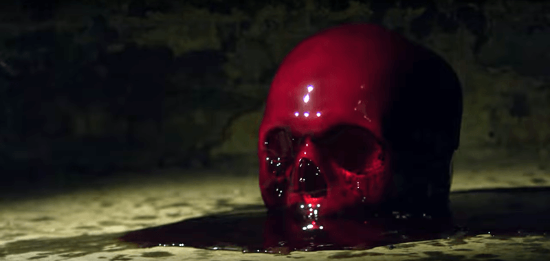 Blood dropped on a skull: A symbolic way of representing the elite's love for blood sacrifices.