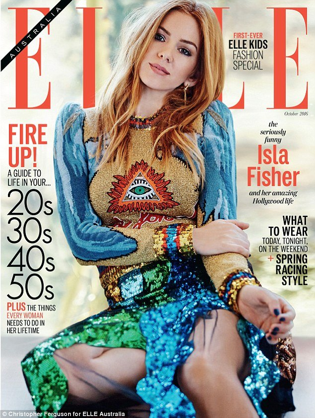 Actress Isla Fisher is on the cover of Elle Australia with a rather visible Illuminati symbol right on her chest. That is kind of like farmers branding cattle with a hot iron.