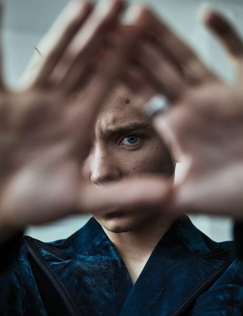 Asa Butterfield is another young English man who has to do the elites symbolism. Here is doing the Illuminati sign with his hands and eye in Schön! magazine.